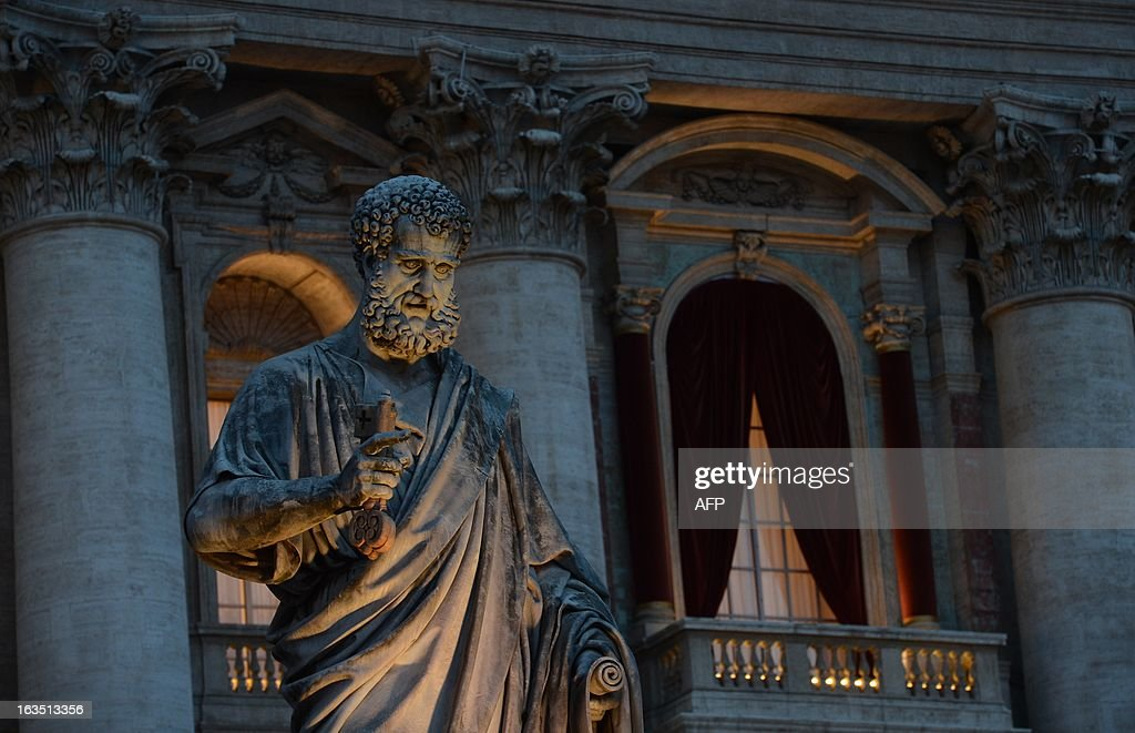 A picture shows the St Peter's statue in front of the main window of the St Peter's basilica on the eve of the conclave on March 11, 2013 at the Vatican. Catholic cardinals had a final day of jockeying for position the same day before shutting themselves into the Sistine Chapel to elect a new pope after Benedict XVI's shock resignation, with an Italian and a Brazilian who both head powerful archdioceses among the top contenders. AFP PHOTO / FILIPPO MONTEFORTE