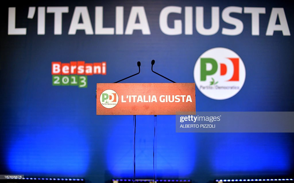A picture shows the stage of the Democratic Party (PD) with the slogan 'L'Italia Giusta' (Italy Right) at the PD headquarters in Rome on February 25, 2013. Italy's centre-left was poised to beat Silvio Berlusconi on Monday but might fail to win the upper house and require a coalition in a nail-biting finish to key elections in which a new anti-austerity party is also set to make inroads. Democratic Party leader Pier Luigi Bersani and his leftist coalition were shown ahead in exit polls with between 34.5 and 37 percent overall, beating the 29 to 31 percent for former premier Berlusconi. The newcomer Five Star Movement led by former comedian turned activist Beppe Grillo, who has stirred public anger at politicians and budget cuts, looked set to come in third with around 20 percent. AFP PHOTO / ALBERTO PIZZOLI
