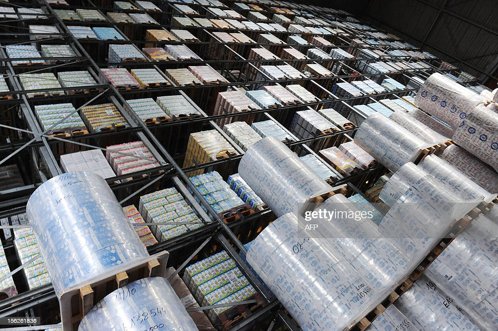 A picture shows the storage hall of the Candia milk packaging site on November 12, 2012 in Le Lude, western France. The group announced on November 8, 2012 the upcoming closing of the factory in 2014 and also intends to close three of its Candia milk packaging sites thus eliminating 313 jobs. AFP PHOTO / JEAN-FRANCOIS MONIER