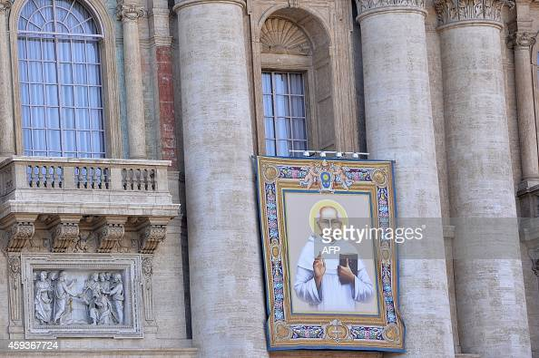 A picture shows the tapestry of priest Kuriakose Elias Chavara on November 21 2014 at St Peter's basilica in Vatican two days before a Holy mass for...