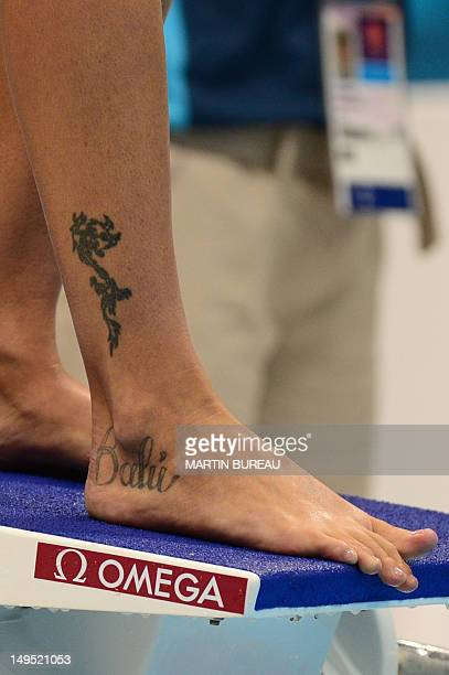 A picture shows the tattoo on Italy's Federica Pellegrini's ankle as she stands on the starting platform at the start of the women's 200m freestyle...