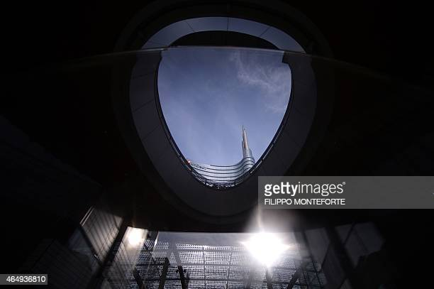 A picture shows the top of the Unicredit tower at Piazza Gae Aulenti in the business district of Porta Nuova on February 27 2015 in Milan Qatar's...