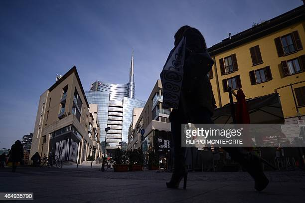 A picture shows the top of the Unicredit tower in the business district of Porta Nuova on February 27 2015 in Milan Qatar's sovereign fund has...