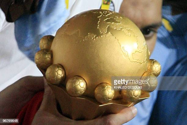 A picture shows the trophy of African Cup as Egyptian players hold it during their celebration after winning their football final match against Ghana...