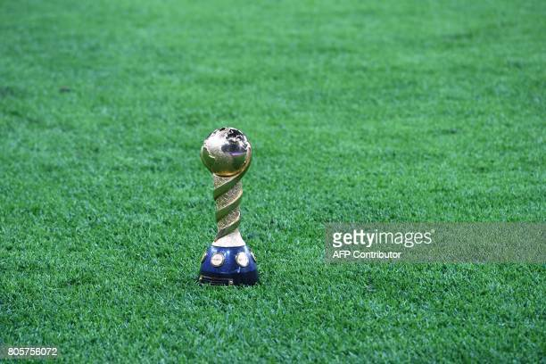 A picture shows the trophy on the pitch at the end of the 2017 Confederations Cup final football match between Chile and Germany at the Saint...