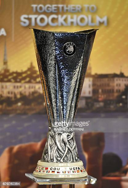 A picture shows the UEFA Europa League trophy ahead of the round of 32 draw of the UEFA Europa League football tournament at the UEFA headquarters in...