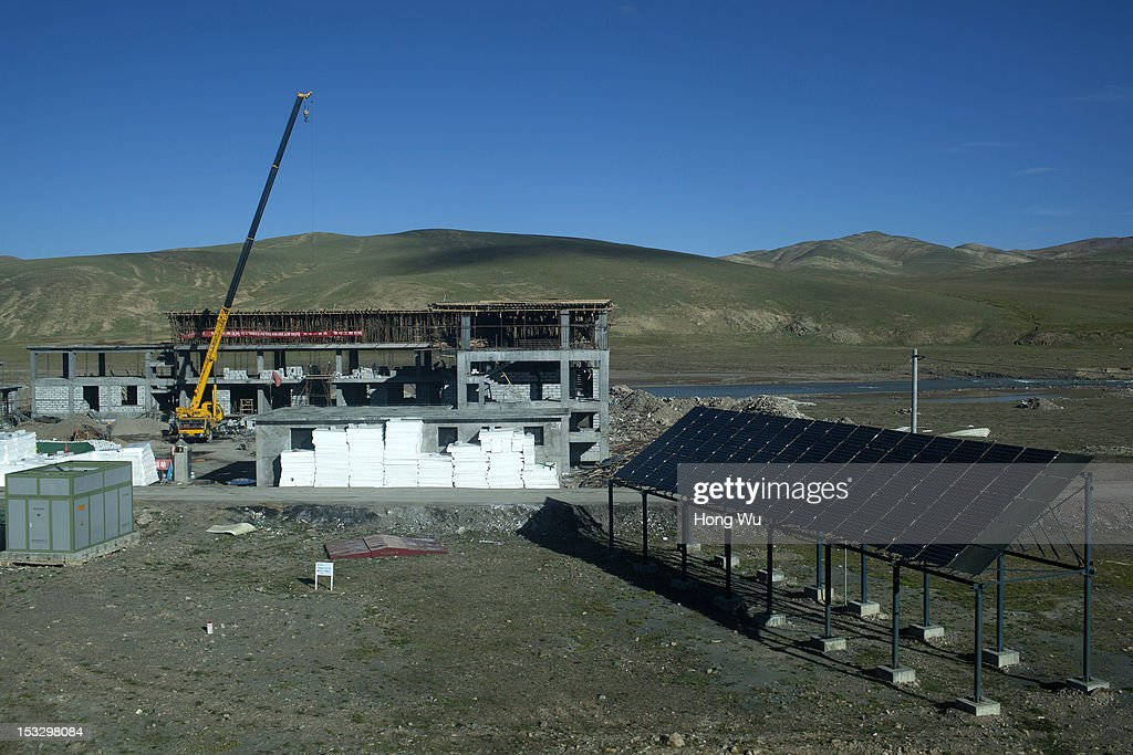 Picture shows the under construction building taken in a train carriage of from Beijing to Lhasa on August 15, 2012 in Amdo, China. After Qinghai-Tibet Railway went into operation on July 1, 2006, connecting China's capital Beijing and Lhasa of Tibet Autonomous Region by 4,064 km of railway line. Passengers and supplies are transported by train on this the world's highest railway to Tibet.