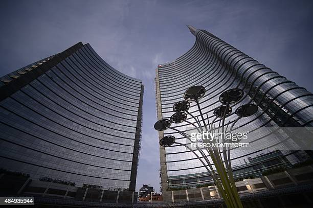 A picture shows the Unicredit tower at Piazza Gae Aulenti in the business district of Porta Nuova on February 27 2015 in Milan Qatar's sovereign fund...