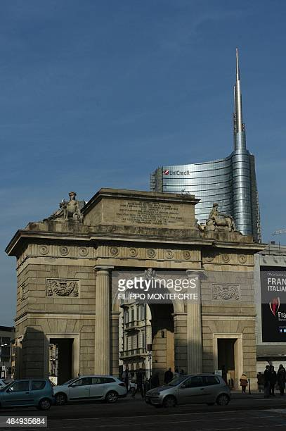 A picture shows the Unicredit tower behind the 'Porta Nuova' monument on February 27 2015 in Milan Qatar's sovereign fund has acquired full control...