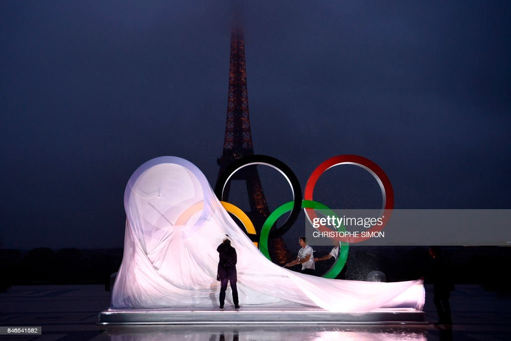 A picture shows the unveiling of the Olympics Rings on the Trocadero Esplanade near the Eiffel Tower in Paris, on September 13, 2017, after the International Olympic Committee named Paris host city of the 2024 Summer Olympic Games. The International Olympic Committee named Paris and Los Angeles as hosts for the 2024 and 2028 Olympics on September 13, 2017, crowning two cities at the same time in a historic first for the embattled sports body. /