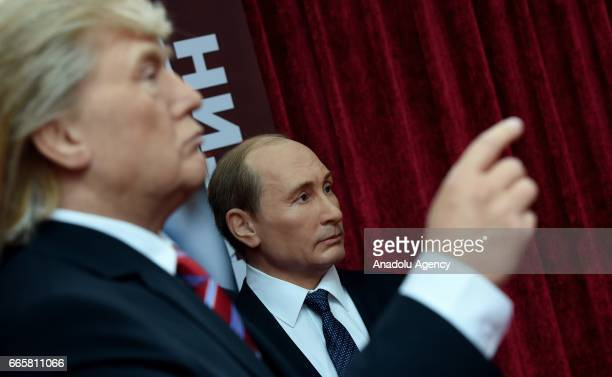 A picture shows the wax figures of the US President Donald Trump and Russian President Vladimir Putin during the exhibition of the wax museum in...
