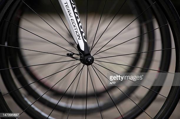 A picture shows the wheel of a bicycle of France's Europcar cycling team prior to the start of a training session on June 29 2012 around Liege...