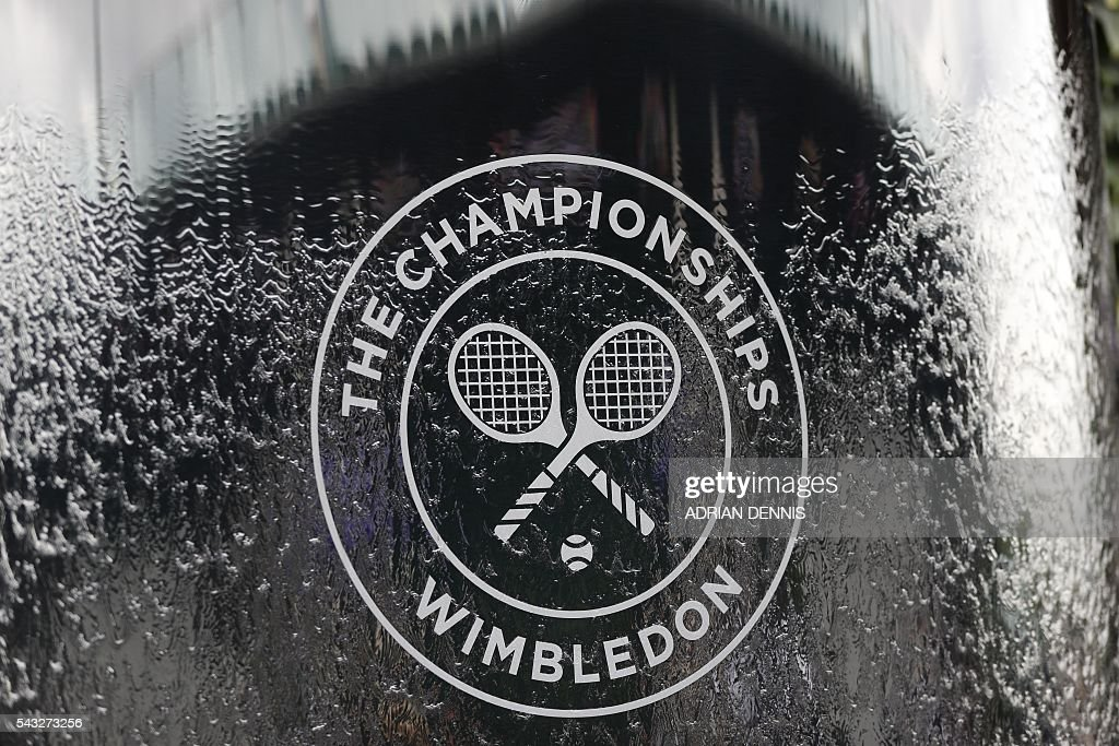 A picture shows the Wimbledon logo at The All England Lawn Tennis Club in Wimbledon, southwest London, on June 27, 2016 on the first day of the 2016 Wimbledon Championships. / AFP / ADRIAN