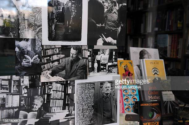 A picture shows the window of the bookshop 'Shakespeare and company' specialized in Englishlanguage literature with pictures of George Whitman the...