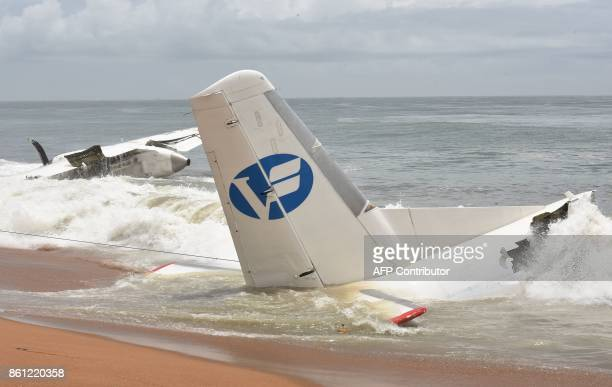 A picture shows the wreckage of a cargo plane that crashed off Ivory Coast killing four on the beach of PortBouet in Abidjan on October 14 2017 An...