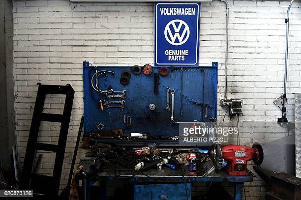 A picture shows tools in the garage Nucci where the 'T1 specialist' team restore vintage Volkswagen Kombi bus on November 3 2016 in Florence Campers...