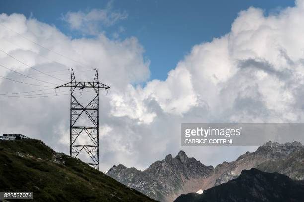 A picture shows transmission towers next to the Nufenen Pass on July 23 2017 / AFP PHOTO / Fabrice COFFRINI