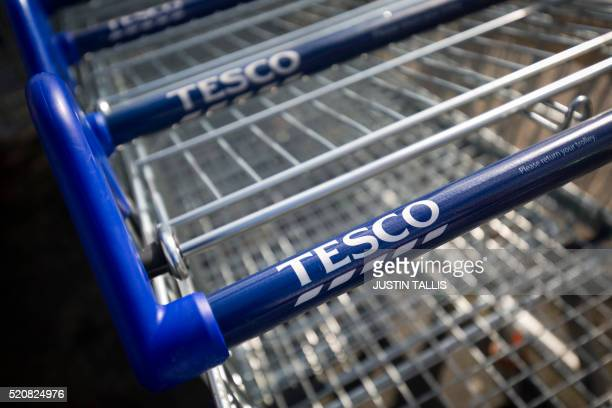 A picture shows trollies at a branch of Tesco supermarket in Brixton south London on April 13 2016 Tesco said on April 13 that it rebounded into...