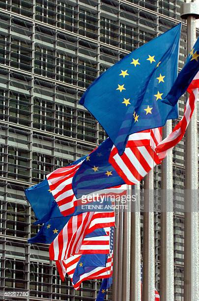 Picture shows US and European flags waving in front of the Berlaymont building headquarters of the European Commission during a EUUS Summit 22...