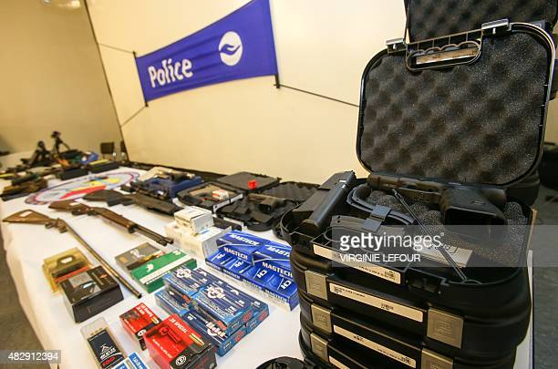 A picture shows weapons seized by Belgian police as part of the fight against arms trafficking at the Charleroi police headquarters in Marcinelle on...