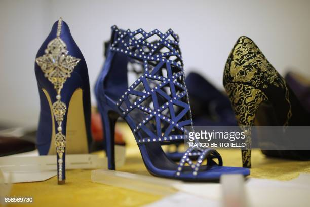 A picture shows women shoes with gold dust patterns and Swarovski crystals made by artisans for AV Fashion on March 16 2017 in Turin Antonio Vietri...