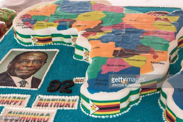 A picture shows Zimbabwean President Robert Mugabe's birthday cake in the shape of the map of Africa during celebrations marking his birthday at the...