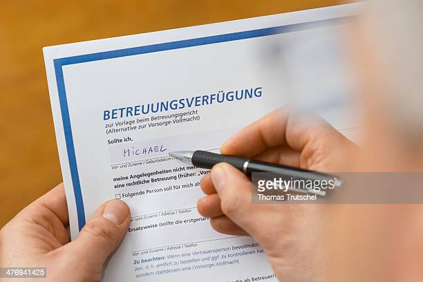 Picture symbolizing health care proxy a man filling out a health care proxy form on March 05 2014 in Berlin Germany