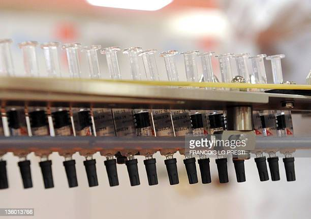 Picture syringe on a vaccine production line taken on December 16 2011 at the new plant of UK's largest drug maker GlaxoSmithKline in...