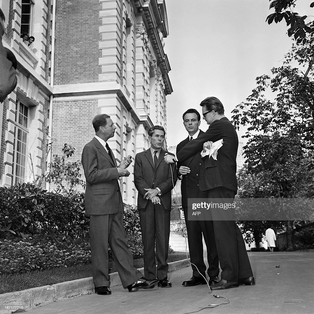 A picture taekn on October 14, 1965 in Paris shows France's medicine nobel prize co-laureates Andre Lwoff (L) Francois Jacob (3rdR) and Jacques Monod (C) answering journalists' questions at the Institut pasteur. French biologist Francois Jacob, who won the 1965 Nobel prize for medicine for his research into enzymes, has died at the age of 92, a relative told AFP on April 21, 2013.
