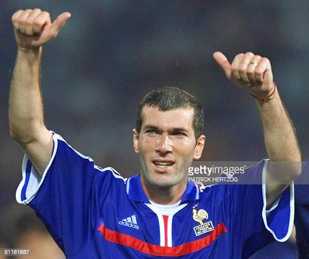 Picture taken 02 July 2000 shows French playmaker Zinedine Zidane celebrating at the end of the Euro2000 soccer championships after France won the...