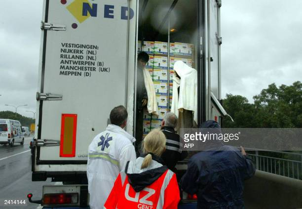 picture taken 03 July 2002 shows illegal asylum seekers caught by rescue workers and the police while travelling in an English lorry on the E40...