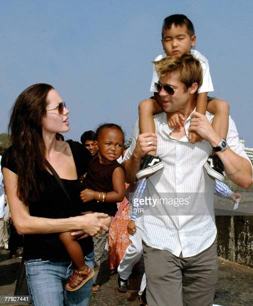 FILES A picture taken 12 November 2006 shows US actors Angelina Jolie daughter Zahara husband Brad Pitt and son Maddox taking a stroll on the...
