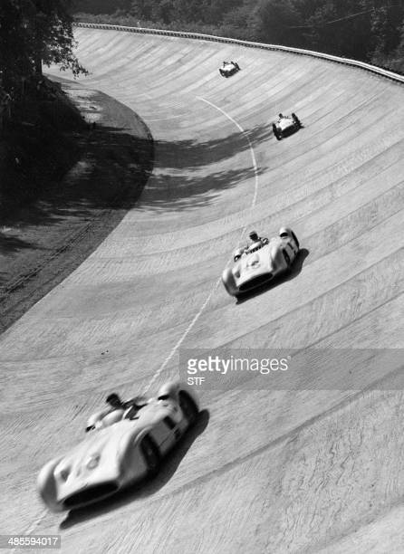 Picture taken 13 September 1955 at the Monza race track near Milan of Argentinian Mercedes driver Juan Manuel Fangio ahead of a teammate during the...