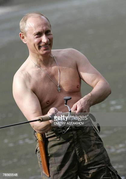 FILES Picture taken 15 August 2007 shows Russian President Vladimir Putin fishing on the Khemchik River near the foothills of the Western Sayan...