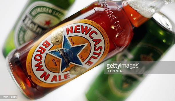 A picture taken 15 November 2007 shows a bottle of Newcastle Brown Ale made by British brewery Scottish and Newcastle against the backdrop of...
