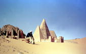 Picture taken 16 December 2000 shows Hamid Abdullah the Sudanese guardian of the Pyramids of Meroe sitting in front of the ancient royal tombs in...