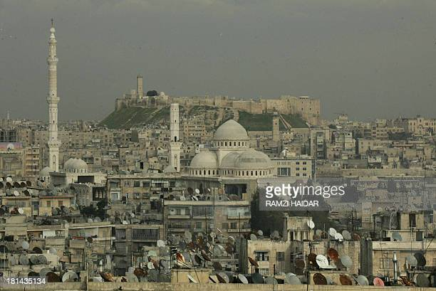 A picture taken 17 March 2006 shows a general view of the historic Syrian city of Aleppo 350 kms north of Damascus with its landmark cytadel in the...
