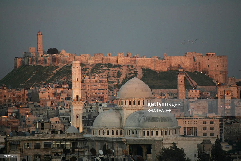 A picture taken 17 March 2006 shows a general view of the historic Syrian city of Aleppo, 350 kms north of Damascus, with its landmark cytadel in the background. Hundreds of Arab and foreign personalities will gather in Aleppo this weekend to celebrate its choice as the Arab world's capital of Islamic culture for 2006. Syrian Culture Minister Riad Nassan Agha said yesterday Aleppo was chosen by the Organization of the Islamic Conference (OIC) because of its role as the 'main point of passage between East and West.' Two days of inaugural festivities will kick off 18 March 2006 with the rededication of the 12th-century Great Mosque (C), which has been under restoration for the past five years.