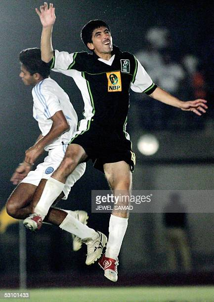 Picture taken 18 June 2005 shows Pakistani national football team striker Mohammad Essa vying for the ball with an Indian opponent during the final...