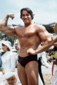 Picture taken 19 May 1977 of shows American actor Arnold Schwarzenegger posing during the 38th Cannes film festival where he presented Pumping Iron a...