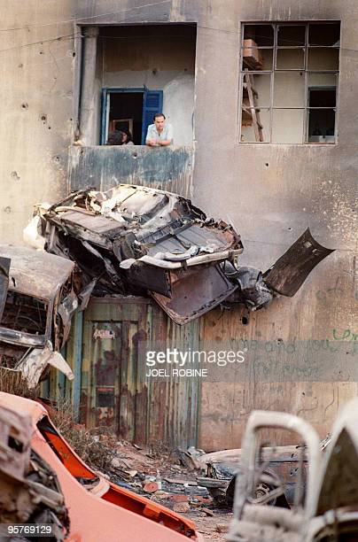 Picture taken 20 April 1989 of destroyed cars in a devastated street of East Beirut a Christian enclave of Lebanese capital On the battle front...