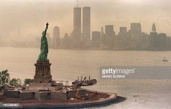A picture taken 20 May 1986 in New York shows the Statue of Liberty and the Twin Towers of the World Trade Center in the background The Twin Towers...