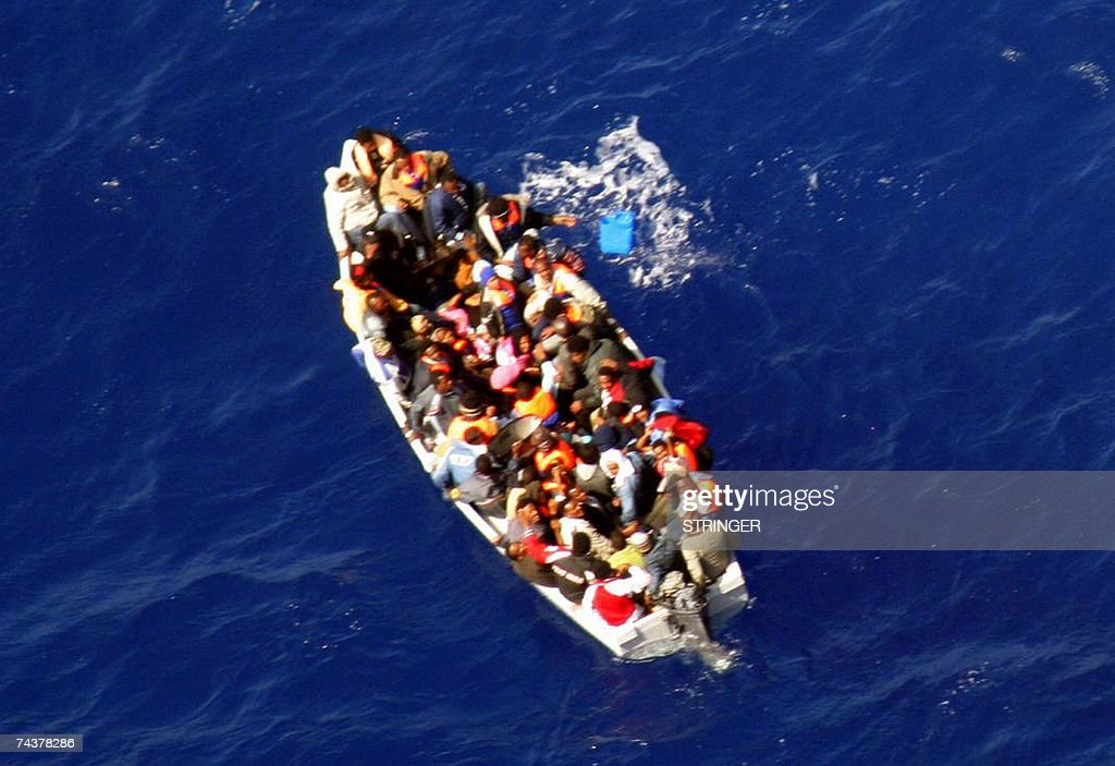 Picture taken 21 May 2007 of A small boat packed with 53 illegal immigrants adrifting and taking on water south of the Mediterranean island of Malta...