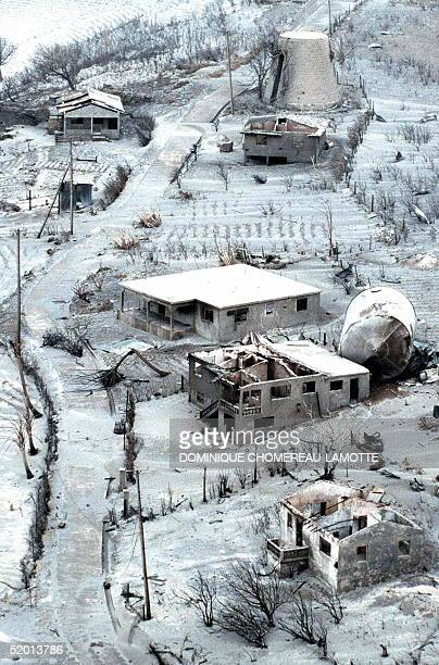 picture taken 27 June showing destroyed houses on the northeast part of Montserrat island after the eruption of the Soufriere Hills volcano The...