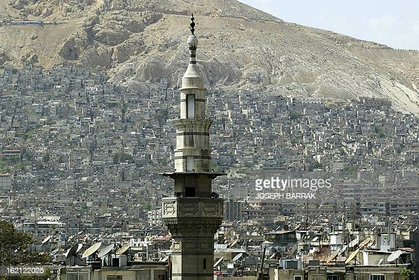 Picture taken 28 April 2004 shows a mosque minaret in Damascus city The Syrian capital went on high security alert after a series of explosions and a...
