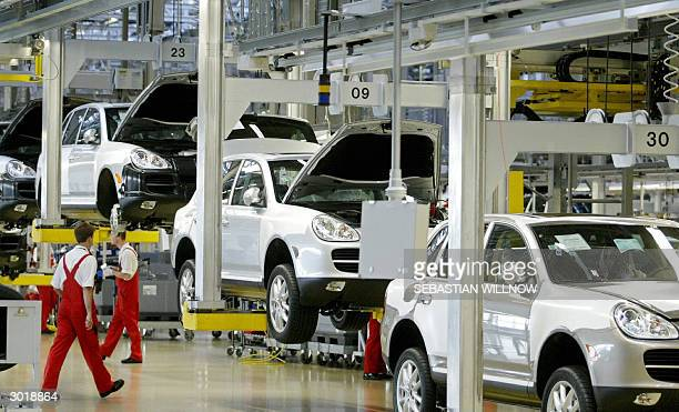 FILES Picture taken 28 August 2003 shows employees working at the assembly line of 4 by 4 Porsche Cayenne cars at the Porsche plant in the eastern...