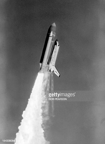 Picture taken 28 January 1986 showing the solid fuel rocket booster of the space shuttle Challenger starting to explode over Kennedy Space Center The...