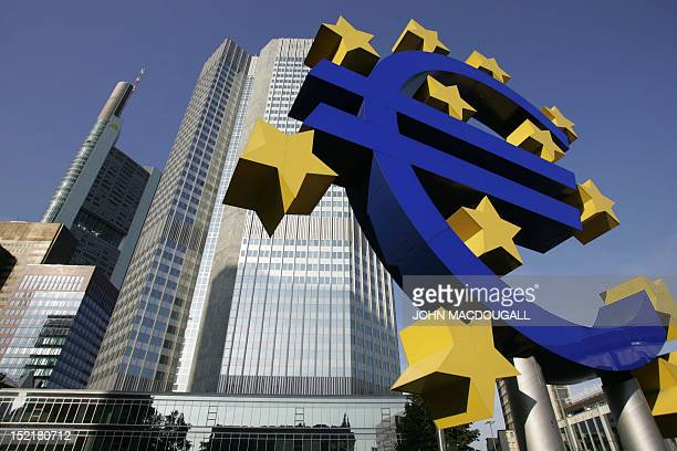 FILES A picture taken 28 June 2005 shows a giant Euro symbol the currency of the EU standing in front of Frankfurt's Eurotower which houses the...