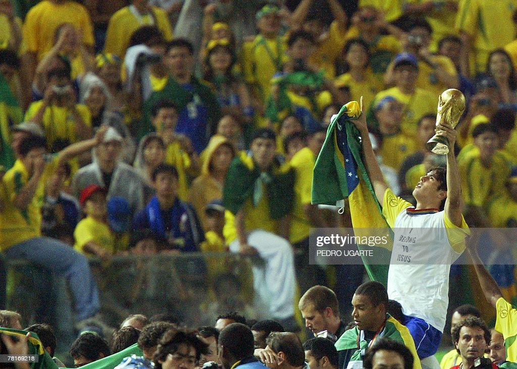Picture taken 30 June 2002 of Brazilian forward Kaka brandishing the trophy at the end of the Germany/Brazil final of the 2002 FIFA World Cup Kaka is...