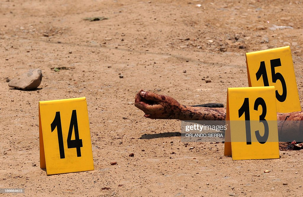Picture taken at a crime scene in which five people -- including a high school student -- were shot dead in the suburb of La Haya, in northern Tegucigalpa, on April 15, 2013. In March 2012, the UN announced Honduras had the world's highest murder rate, at 82.1 deaths per 100,000 people, while a local observatory on violence put the rate at 86.5 per 100,000. AFP PHOTO/Orlando SIERRA